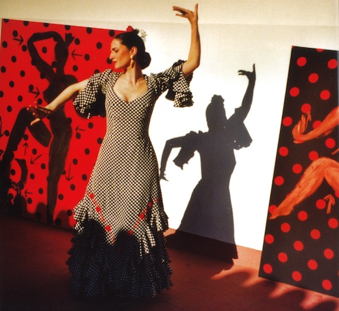 Flamenco dancer in front of Szczesny paintings